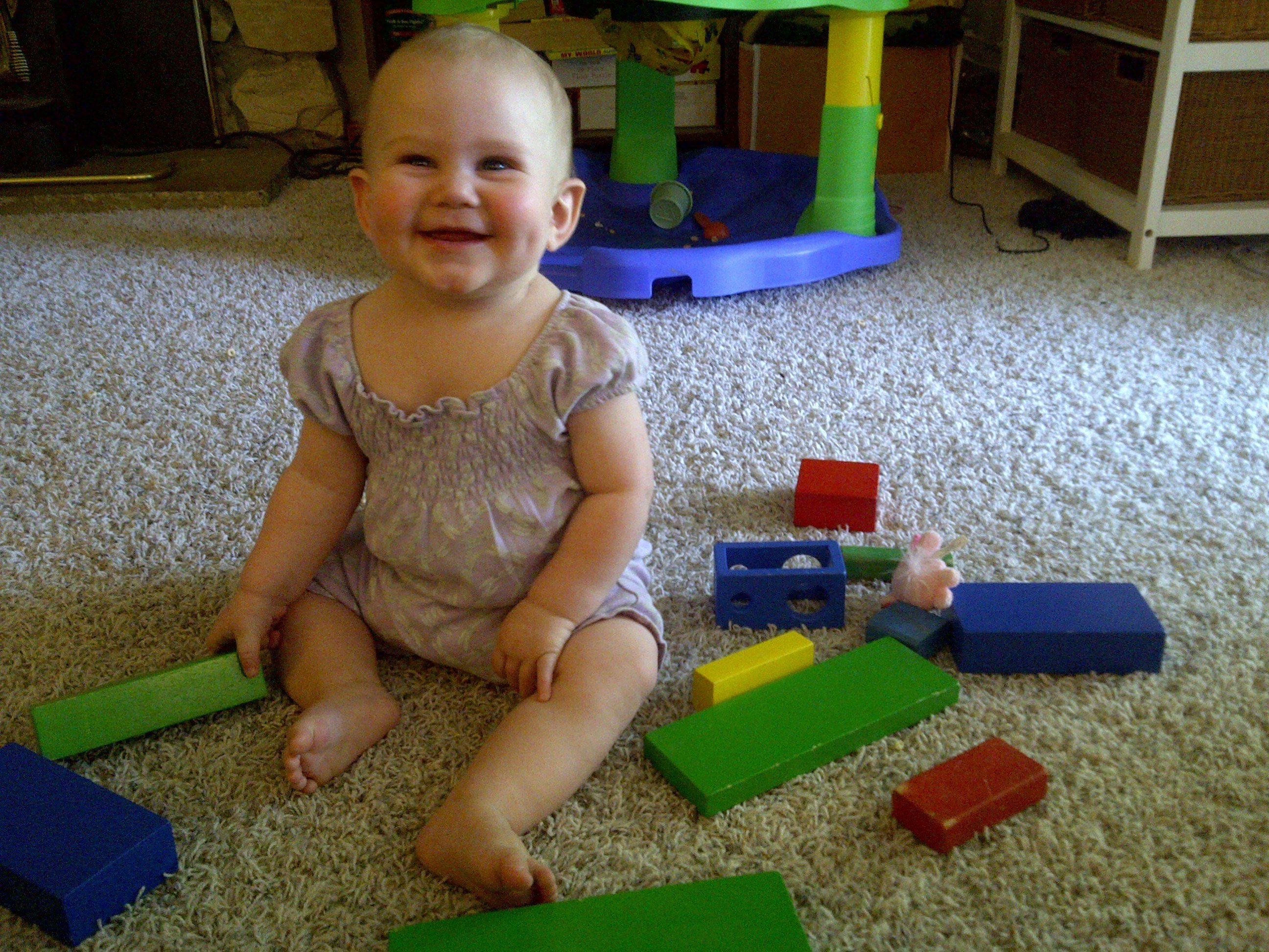 not making the milk sign, but still damn cute playing with blocks