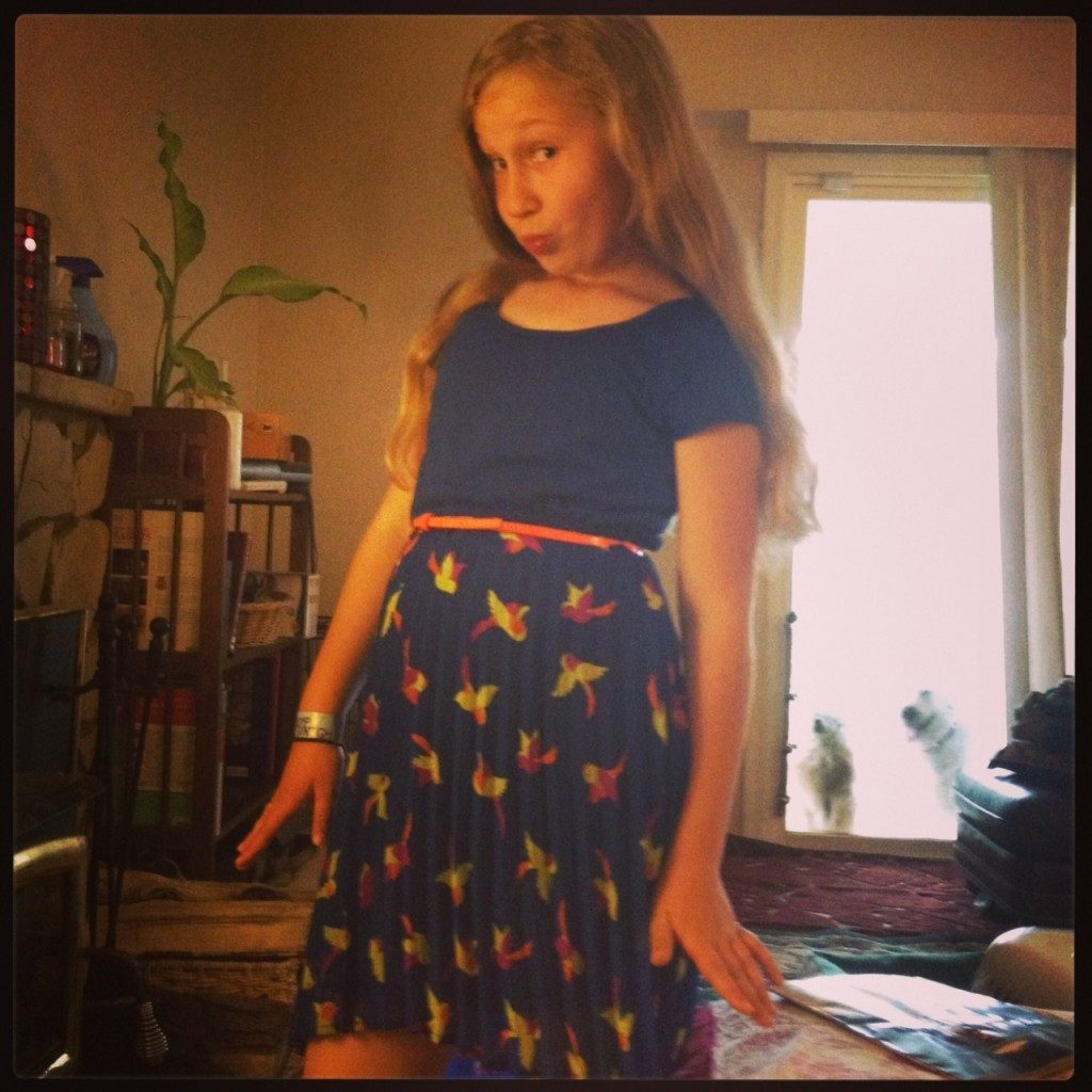 """Ava making fun of """"duck face"""" in her new dress"""